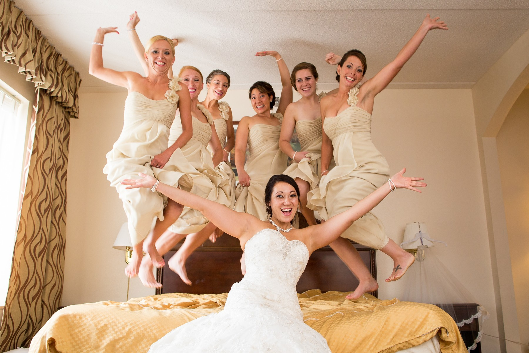 wedding-jumping-on-bed-bride