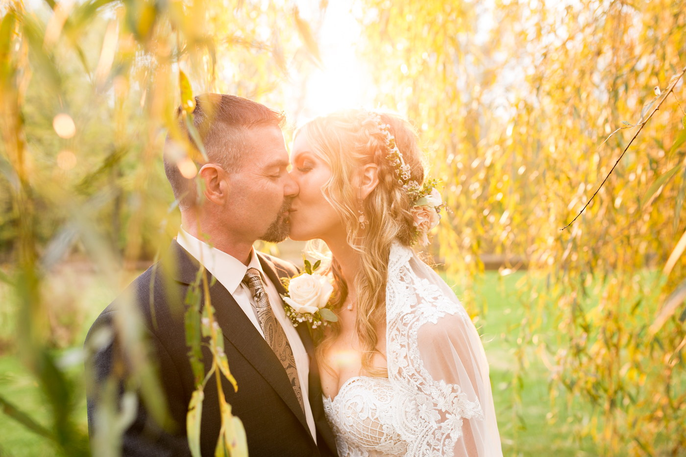 sunset bride groom weeping willow tree stone barn winery
